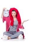 Huisvrouw met klok Stock Foto's