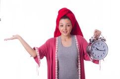 Huisvrouw met klok Royalty-vrije Stock Afbeelding
