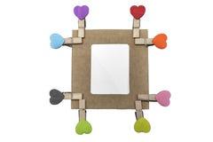 Huit agrafes de coeur avec le cadre de carton Photographie stock libre de droits