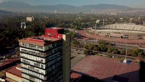 Aerial drone view of the central campus of UNAM, Mexico City stock video footage