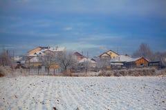 Huizen in de winter Stock Afbeelding