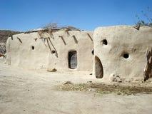 Huizen in de woestijn Stock Foto's
