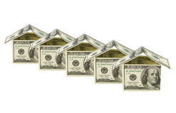 Huizen die van geld worden gemaakt Stock Afbeeldingen