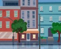 Huizen op straat met weg in stad Regen in de stad Cityscape Royalty-vrije Stock Afbeelding