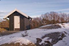 Huizen van houten, geschilderde zwarte worden gemaakt die Stock Afbeelding