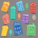 Huizenkrabbels op gekleurde achtergrond Royalty-vrije Stock Afbeeldingen