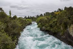 Huka falls strong current. Powerful force, Waikato River, New Zealand Royalty Free Stock Photo