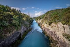 Huka Falls is a high waterfall in New Zealand. Huka Falls is a thundering high waterfall and the most visited and photographed natural attraction in New Zealand royalty free stock photo