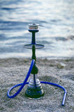 Huka und tobacoo auf einem Strand Stockfoto