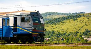 Ancient electric train arrival. Huklyvyi, Ukraine - 20 Jul, 2017: ancient electric train arrival. moving fast in mountains royalty free stock image