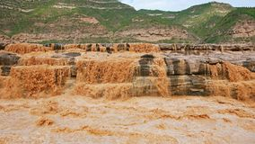 "Hukou Falls of Yellow River. The Yellow River Hukou Waterfall, known as the ""the Yellow River wonder"", is the only yellow waterfall in the Yellow River Royalty Free Stock Photo"
