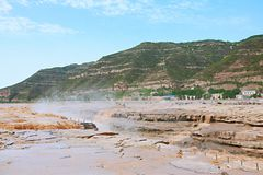 "Hukou Falls of Yellow River. The Yellow River Hukou Waterfall, known as the ""the Yellow River wonder"", is the only yellow waterfall in the Yellow River Royalty Free Stock Photography"