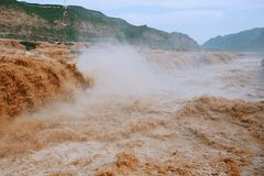 Hukou Falls of Yellow River. The Yellow River Hukou Waterfall, known as the & x22;the Yellow River wonder& x22;, is the only yellow waterfall in the Yellow River Royalty Free Stock Images