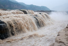 Hukou Waterfall of China's Yellow River. Hukou Waterfall is located in the Yellow River on the Shanxi-Shaanxi border. At 50 meters high, it is the largest Stock Photos