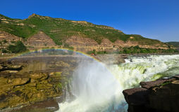 Hukou Waterfall Of The Yellow River. Rainbow Jun in the norning Jixian Shanxi province China Royalty Free Stock Images