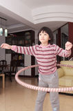 Hula asiatique de gosse hooping Photos libres de droits