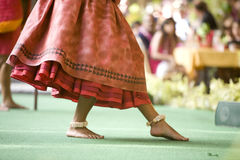 Hula Dancer Feet. Close up of a hula dancer on a stage, focus on the her feet royalty free stock image
