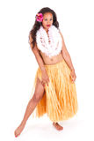 Hula dancer showing leg Stock Photography