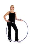 Hula Fitness. Fit blond woman holding a hula hoop, fitness theme Royalty Free Stock Images