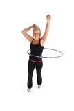Hula Fitness. A blond woman exercising using a hula hoop Stock Photo