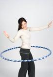Hula hoop. Happy girl doing hula hoop royalty free stock images