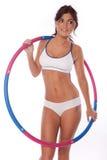 Hula hoop. Women exercise hula hoop on white background royalty free stock images