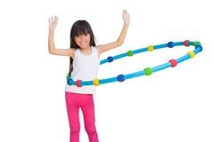 Hula Hoop. Little girl with hula hoop, Isolated on white stock photography