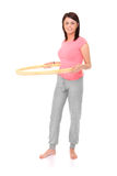 Hula-hoop. A picture of a young happy woman with a hula-hoop over white background stock photography