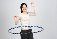 Hula hoop. Happy girl dooing hula hoop stock photography