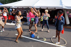Hula Hoop Dancing Women Stock Photo