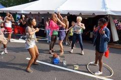 Hula Hoop Dancing Women Stock Photo