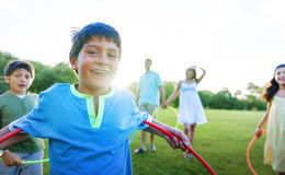 Hula Hoop Enjoying Cheerful Outdoors Leisure Concept royalty free stock photography