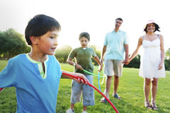 Hula Hoop Enjoying Cheerful Outdoors Leisure Concept royalty free stock images
