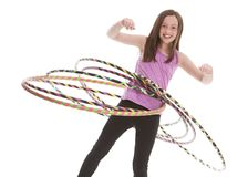 Hula Hoop Fun. Attractive, fit preteen hula hooping with several hoops.  Isolated on white Stock Photography