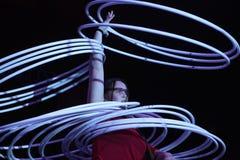 Hula hoop juggler Alexandra Soboleva. DRESDEN, GERMANY - MARCH 31, 2014: Hula hoop juggler Alexandra Soboleva (Ukraine) performs with Russian Grand Circus in Royalty Free Stock Photography