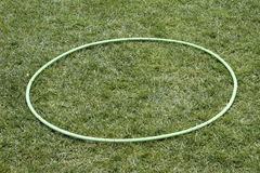 Hula hoop. Lying on the grass Royalty Free Stock Photo