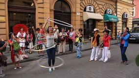 Hula hoop performer. From Croatia Jelena Znaor performing in Zagreb while Chinese tourist are watching