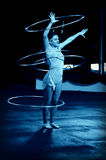 Hula Hoop Performer. A hula hoop performer entertains the crowd under the big top at Circus World Museum in Baraboo, Wisconsin royalty free stock image