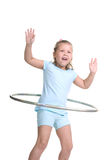 Hula hooping kid. Adorable young blond girl hula hooping on white background Royalty Free Stock Photo
