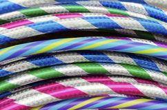 Hula Hoops. Pattern of brightly striped hula hoops in the toy store royalty free stock photography