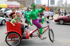 The Hulk. A pedicab dressed as the incredible hulk gives SXSW festival goers a ride Stock Photo