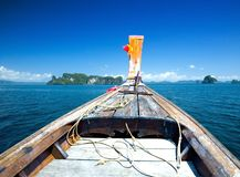 Hull of long tail boat travelling on sea Royalty Free Stock Photo