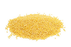 Hulled millet. A mound of hulled millet on a white background Royalty Free Stock Image