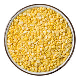 Hulled split mung bean. Close up hulled split mung bean in ceramic dish isolated on white - with path Royalty Free Stock Photo