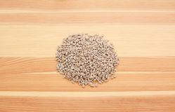 Hulled sunflower seed hearts on wood. Hulled sunflower seed hearts on a wooden background, pine wood grain Stock Photo