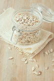 Hulled sunflower seeds in glass jar on wooden rustic background Royalty Free Stock Photography
