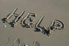 HULP die in zand wordt geschreven Royalty-vrije Stock Afbeelding