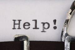 Hulp op oude schrijfmachine Royalty-vrije Stock Afbeeldingen