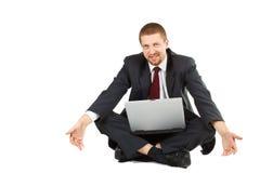 Hulpeloze zakenman met laptop in zijn overlapping Stock Fotografie