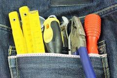 Hulpmiddelen in een blauwe zak van Jean Stock Afbeelding